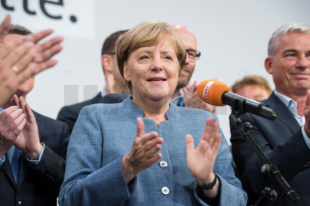 24 SEP 2017, BERLIN/GERMANY:<br /> Angela Merkel (M), CDU, Bundeskanzlerin, tritt zum zweiten Mal an das Mikrofon, Wahlparty in der Wahlnacht, Bundestagswahl 2017, Konrad-Adenauer-Haus, CDU Bundesgeschaeftsstelle<br /> IMAGE: 20170924-01-056<br /> KEYWORDS: Election Party, Election Night, klatscht, applaudiert, klatschen, Applaus