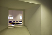 Unoccupied meeting room seen through square window at London Metropolitan University's Holloway Road campus.