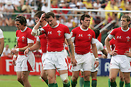 Craig Hill (c) and his Welsh teammates leave the field in dissapointment  as they lose the match. IRB Emirates airline Dubai sevens 2008. match 35 action, Bowl semi  final between  Wales and Portugal  at the Sevens Stadium in Dubai on Sat 29th November 2008..pic by Andrew Orchard.