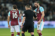 Andy Carroll of West Ham United  (r) arguing with Referee Kevin Friend. Premier league match, West Ham Utd v Manchester city at the London Stadium, Queen Elizabeth Olympic Park in London on Wednesday 1st February 2017.<br /> pic by John Patrick Fletcher, Andrew Orchard sports photography.