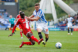 Albert Adomah of Middlesbrough is challenged by Jack Robinson of Huddersfield - Photo mandatory by-line: Rogan Thomson/JMP - 07966 386802 - 13/09/2014 - SPORT - FOOTBALL - Huddersfield, England - The John Smith's Stadium - Huddersfield town v Middlesbrough - Sky Bet Championship.