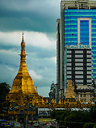 10 NOVEMBER 2015 - YANGON, MYANMAR:    Sule Pagoda, on Sule Pagoda Rd, is located in the heart of downtown Yangon, occupying the center of the city. According to legend, it was built before the Shwedagon Pagoda during the time of the Buddha, making it more than 2,500 years old. The Sule Pagoda has been the focal point of both Yangon and Burmese politics. It was a rallying point in both the 1988 uprisings and 2007 Saffron Revolution.        PHOTO BY JACK KURTZ
