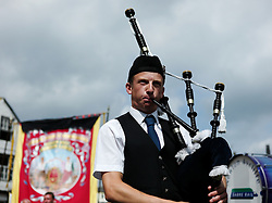 "© Licensed to London News Pictures. 13/07/2013<br /> <br /> Durham City, England, United Kingdom<br /> <br /> A piper plays as part of a colliery band during the Durham Miners Gala.<br /> <br /> The Durham Miners' Gala is a large annual gathering held each year in the city of Durham. It is associated with the coal mining heritage of the Durham Coalfield, which stretched throughout the traditional County of Durham, and also gives voice to miners' trade unionism. <br /> <br /> Locally called ""The Big Meeting"" or ""Durham Big Meeting"" it consists of banners, each typically accompanied by a brass band, which are marched to the old Racecourse, where political speeches are delivered. In the afternoon a Miners' service is held in Durham Cathedral <br /> <br /> Photo credit : Ian Forsyth/LNP"