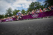 Venezuelan Tomas Aurelio Gil Martinez races past fans lining the route through Bushy Park in south west London, during the London 2012 Olympic 44km men's cycling time trial, eventually won by Team GB's Bradley Wiggins.