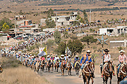 Mexican cowboys form ten mile long procession as they ride through a village during the annual Cabalgata de Cristo Rey pilgrimage January 4, 2017 in Guanajuato, Mexico. Thousands of Mexican cowboys and horse take part in the three-day ride to the mountaintop shrine of Cristo Rey stopping along the way at shrines and churches.