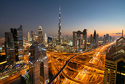 Skyline of Dubai, Sheikh Zayed Road and Burj Khalifa skyscraper at dusk in Dubai, United Arab Emirates