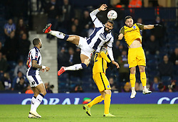 """West Bromwich Albion's Kyle Bartley (centre) and Brighton & Hove Albion's Florin Andone (right) compete for a header during the FA Cup fourth round replay match at The Hawthorns, West Bromwich. PRESS ASSOCIATION Photo. Picture date: Tuesday February 5, 2019. See PA story SOCCER West Brom. Photo credit should read: Aaron Chown/PA Wire. RESTRICTIONS: EDITORIAL USE ONLY No use with unauthorised audio, video, data, fixture lists, club/league logos or """"live"""" services. Online in-match use limited to 120 images, no video emulation. No use in betting, games or single club/league/player publications."""