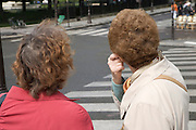 two elderly ladies one scratching her ears with brown dyed hair