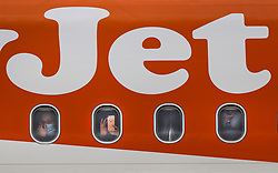 © Licensed to London News Pictures. 17/05/2021. Crawley, UK. Air passengers look out from an EasyJet flight as it waits to take off to Faro in Portugal from Gatwick Airport as step three on the roadmap out of lockdown begins. Travel to 12 countries on the green list is allowed from today. Holiday-makers returning home from green listed countries, including Portugal, Gibraltar and Iceland will not have to self-isolate on return. Various hospitality rules are also changing today - with pubs and restaurants allowed to serve seated customers indoors. Photo credit: Peter Macdiarmid/LNP