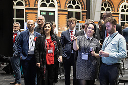 © Licensed to London News Pictures . 26/05/2019. Manchester, UK. People watch results on TV screens in the counting hall . The count for seats in the constituency of North West England in the European Parliamentary election , at Manchester Central convention centre . Photo credit: Joel Goodman/LNP