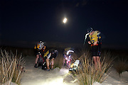 The GeoQuest 48 is Australia's premier adventure race which involves 48 hours of non-stop endurance racing in the major disciplines of trekking, mountain biking and kayaking. Mixed, male or female teams of four navigate through an arduous 200 plus kilometre course that is only revealed to them the evening before the race.Pic shows...Competitors walk through the dunes at Sandbar, (Smiths Lake) , headed to the finish line on day two of the the GeoQuest 48 hour Adventure race held around the Barrington Tops and Forster Great Lakes area on June 7, 2009 in New South Wales, Australia. <br /> Date 6/6/09 Photo by Craig Golding/Getty Images