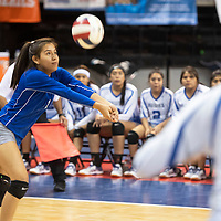 Julianna Carrillo (1) bumps for Laguna Acoma against  Dexter Friday morning at the Santa Ana Star Center in the NMAA Class 3A State Volleyball tournament in Rio Rancho. The Hawks beat Dexter in four sets.