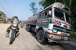 Tattoo artist Justin Big Meas Wilson riding a Royal Enfield Himalayan in Motorcycle Sherpa's Ride to the Heavens motorcycle adventure in the Himalayas of Nepal. Riding from Chitwan to Daman. Tuesday, November 12, 2019. Photography ©2019 Michael Lichter.