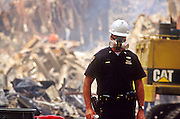 "NEW YORK, NY: A New York police officer wearing a breathing filter stands guard at ""Ground Zero"" of the World Trade Center complex after the WTC terrorist attack, Sept. 22, 2001. Almost 3,000 people were killed when terrorists crashed hijacked passenger jets into the twin towers. PHOTO BY JACK KURTZ"