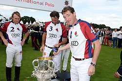 The Audi England team, MARK TOMLINSON, JOHN PAUL CLARKIN and  LUKE TOMLINSON and the Westchester Cup at the Audi International Polo at Guards Polo Windsor Great Park, Egham, Surrey on 28th July 2013.