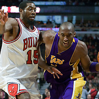 15 December 2009: Los Angeles Lakers guard Kobe Bryant drives past Chicago Bulls John Salmons during the Los Angeles Lakers 96-87 victory over the Chicago Bulls at the United Center, in Chicago, Illinois, USA.
