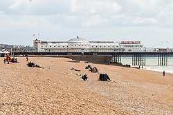 © Licensed to London News Pictures. 28/04/2019. Brighton, UK. Members of the public take advantage of the milder weather by spending time on the beach in Brighton and Hove. Photo credit: Hugo Michiels/LNP