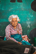 Buddha Laxmi Adhikari is eighty-six years old. After being left homeless when her home was damaged by the 2015 earthquake, she slept outside with her family at the village school.