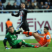 Besiktas's Hugo Almedia (C) during their Turkish superleague soccer match Besiktas between IBBSpor at BJK Inonu Stadium in Istanbul Turkey on Sunday, 11 December 2011. Photo by TURKPIX