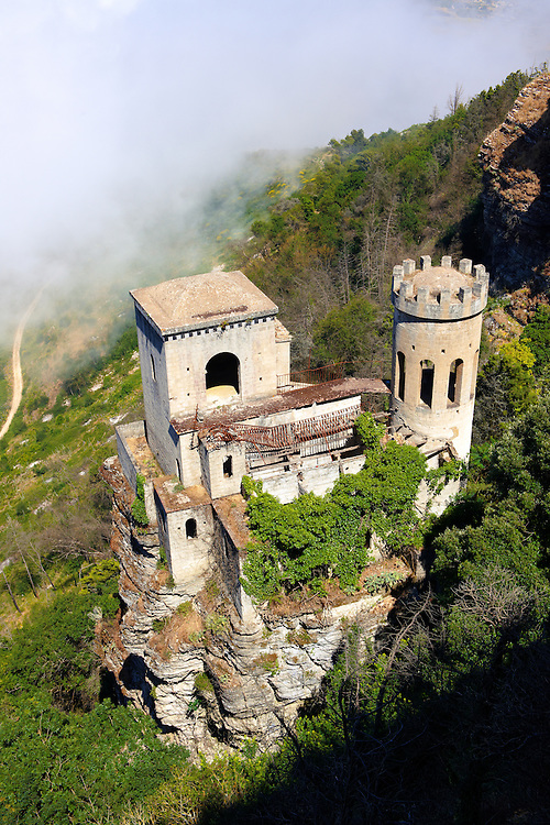 Small Saracen castle the Torretta Pepoli high on Mount Erice looking down 750 metres (2,460 ft) through clouds to Trapani and the Sicilian coast. .<br /> <br /> Visit our SICILY PHOTO COLLECTIONS for more   photos  to download or buy as prints https://funkystock.photoshelter.com/gallery-collection/2b-Pictures-Images-of-Sicily-Photos-of-Sicilian-Historic-Landmark-Sites/C0000qAkj8TXCzro<br /> <br /> <br /> Visit our MEDIEVAL PHOTO COLLECTIONS for more   photos  to download or buy as prints https://funkystock.photoshelter.com/gallery-collection/Medieval-Middle-Ages-Historic-Places-Arcaeological-Sites-Pictures-Images-of/C0000B5ZA54_WD0s