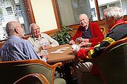 Senior Men Playing Cards