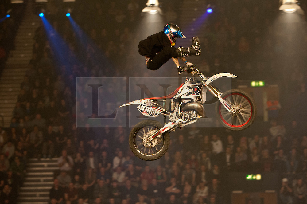 © licensed to London News Pictures. London, UK 14/03/2012. A motorbike rider  performing a stunt during the Masters of Dirt show at Wembley Arena in London on March 14th, 2012. The Masters of Dirt show features top European freestyle riders performing some stunts on motocross motorcycles, along with a host of other machines including minibikes and quads. Photo credit: Tolga Akmen/LNP