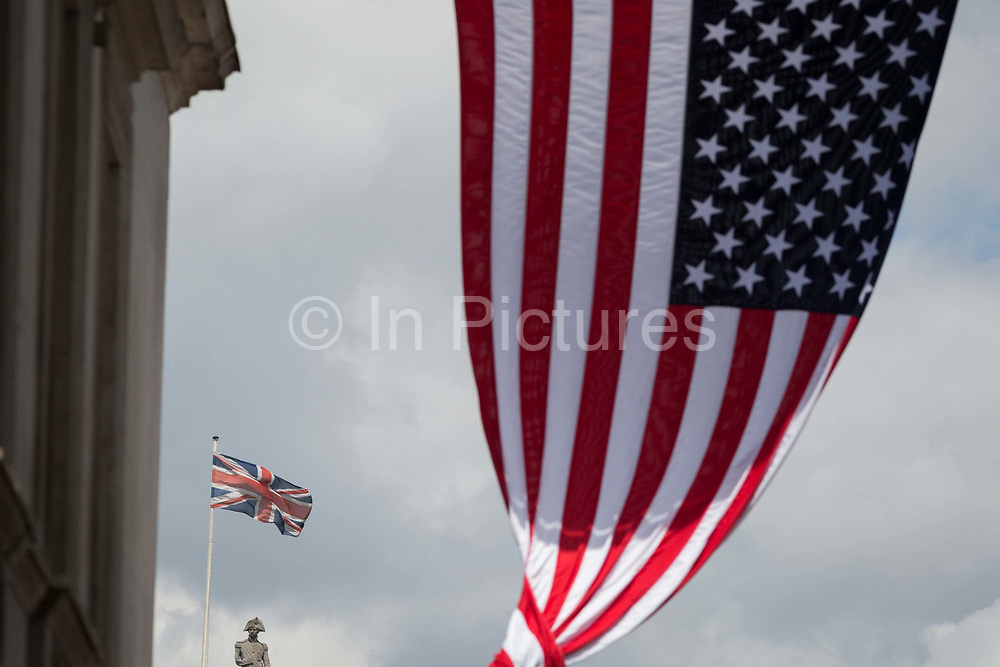 On US President Donald Trumps first day of a controversial three-day state visit to the UK by the 45th American President, the US Stars and Stripes flag hangs on Whitehall with the figure of Lord Nelson on the top of his column in Trafalgar Square, on 3rd June 2019, in London England.
