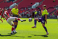 Bristol City's Jack Hunt (2) and Exeter City's Will Dean (41) tussle for the ball during the EFL Cup match between Bristol City and Exeter City at Ashton Gate, Bristol, England on 5 September 2020.