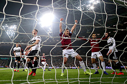 West Ham United's Javier Hernandez (centre) celebrates as team mate Issa Diop (not in frame) scores their sides second goal of the game during the Premier League match at London Stadium.