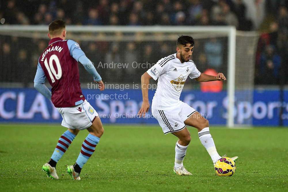 Neil Taylor of Swansea city in action (r).Barclays Premier league match, Swansea city v Aston Villa at the Liberty stadium in Swansea, South Wales on Boxing Day, Friday 26th December 2014<br /> pic by Andrew Orchard, Andrew Orchard sports photography.