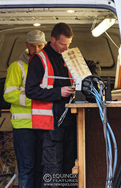 London, United Kingdom - 10 October 2015<br /> Huge drill cuts Virgin fiber cable. Thousand customers without weekend TV and internet. Severed fiber optic cables have caused up to a thousand customers of Virgin Media in Shoreditch and Hackney in London to be left without broadband internet and cable television this weekend. Engineers believe the total loss of service, which continues to be down this Saturday evening, is unlikely to be fixed until Sunday lunchtime at the earliest. The damage to a primary cable carrying 96 fiber optic cables including some belonging to the EE mobile network was caused by a huge drilling rig on a nearby construction site for a block of flats being built by Formation Construction Ltd. An engineer working on the drilling site claimed they had not 'drilled through the cable'. 'We damaged the cable' he said. He then demanded we delete images of the offending drilling rig. Technicians working on behalf of Virgin Media were working hard to replace the damaged cables. Virgin Media press office did not respond to repeated requests to speak with them for comment today.<br /> (photo by: EQUINOXFEATURES.COM)<br /> <br /> Picture Data:<br /> Photographer: Equinox Features<br /> Copyright: ©2015 Equinox Licensing Ltd. +448700 780000<br /> Contact: Equinox Features<br /> Date Taken: 20151010<br /> Time Taken: 16533437<br /> www.newspics.com