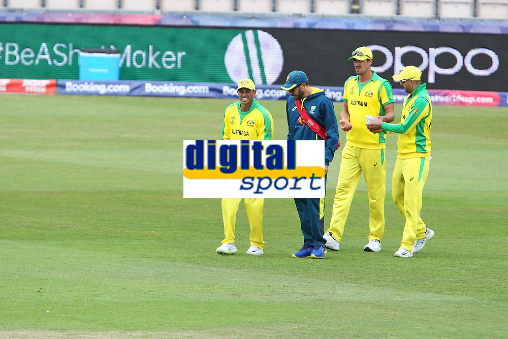 Cricket - 2019 ICC Cricket World Cup warm ups - Australia vs. Sri Lanka<br /> <br /> Usman Khawaja of Australia winces after injuring himself whilst fielding during the cricket world cup warm up match at the Hampshire Bowl Southampton England<br /> <br /> COLORSPORT/SHAUN BOGGUST
