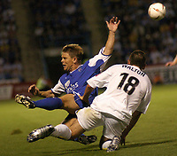 Fotball<br /> England 2004/2005<br /> Foto: SBI/Digitalsport<br /> NORWAY ONLY<br /> <br /> GILLINGHAM VS LEEDS UNITED<br /> COCA-COLA CHAMPIONSHIP AT PRIESTFIELD STADIUM, 10TH AUGUST 2004. <br /> <br /> GILLINGHAM'S ANDY HESSENTHALER IS CHALLENGED FORCEFULLY BY SIMON WALTON