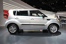 """08  February 2013: 2013 Kia Soul automobile. Chicago Auto Show, Chicago Automobile Trade Association (CATA), McCormick Place, Chicago Illinois<br /> <br /> 2013 Kia Soul: Kia's Soul compact crossover is one of the brand's best-selling vehicles. For 2013, Soul continues with funky """"outside of the box"""" styling, offered in Soul, Soul+ and Soul ! trim levels. Subtle changes include revised Kia badges, dark chrome accents, and exterior paint colors, including Clear White, Dune, Alien green, red-hot Molten, Shadow and Moss. Overall shape of the five-door hatchback has a smoother and more streamlined silhouette, and projects a wider stance. New projector headlights, LED taillights and restyled wheels add a more modern look. All 2013 Soul models amplify the fun-to-drive factor by delivering a class-leading 164 horsepower from the 2.0-liter engine, and 138 hp with the 1.6L. Both are four-cylinders and are available with a choice of the efficient six-speed manual or six-speed automatic transmissions. Soul offers the fuel saving Idle Stop and Go (ISG) technology, that turns off the engine when the vehicle is not in motion and restarts automatically when the driver releases the brake pedal. Inside the five-passenger cabin, available infotainment features include UVO powered by Microsoft voice-activated system, a 4.3-inch color touch screen and rear camera, upgraded leather on the leather-wrapped steering wheel, standard Bluetooth wireless technology with steering wheel-mounted controls. When rear seat are down, the Soul can haul up to 53.4 cu. ft. of cargo."""