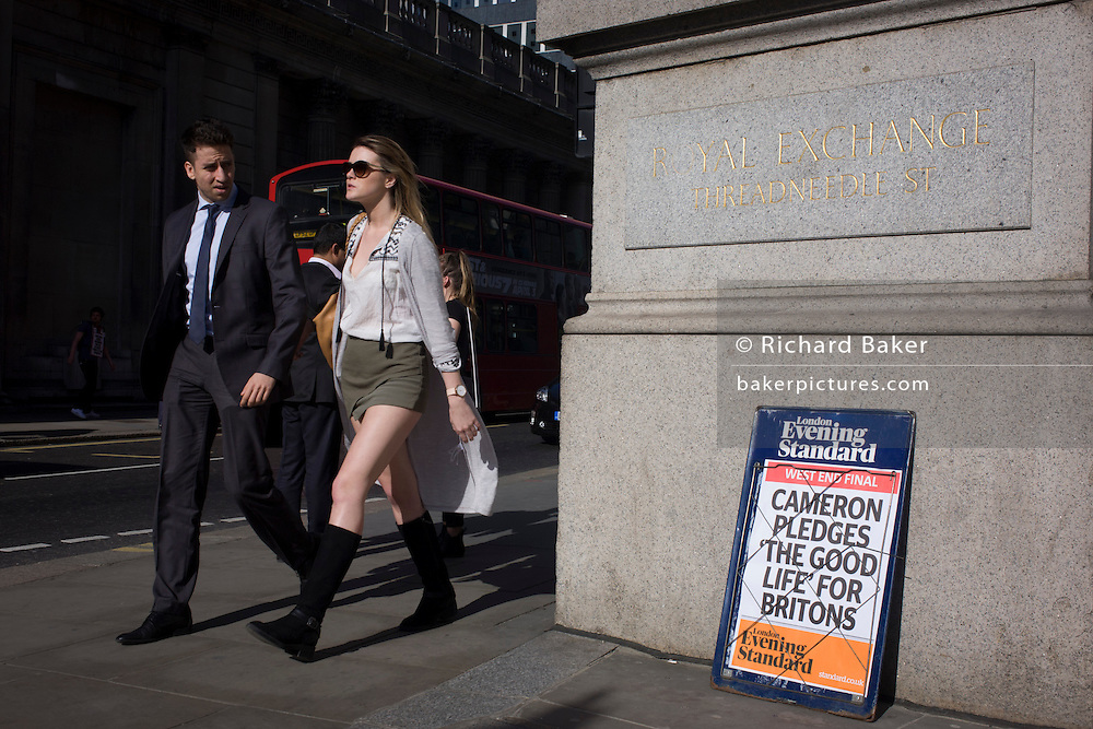 "City workers walk past David Cameron's Conservative party's election promise on Evening Standard headline in the City of London. David Cameron has said his aim is to guarantee a ""good life"" for British workers and families as he launched the Conservatives' election manifesto. The prime minister said he wanted ""to finish the job"" of rebuilding Britain on behalf of ""working people"". Labour said the Conservatives were the ""party of the richest in society""."