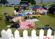 © Licensed to London News Pictures. 27/06/2012. Henley-on-Thames, UK A man sleeps with an abandoned picnic.  Spectators watch rowing crews compete at the Henley Royal Regatta in the early evening sunshine on June 26, 2012 in Henley-on-Thames, England. The 172-year-old rowing regatta is held 27th June- 1st July 2012. Photo credit : Stephen Simpson/LNP