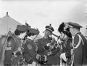 24/05/1958<br /> 05/24/1958<br /> 24 May 1958<br /> Military tattoo at Santry Stadium, Dublin. The visiting U.S.A.F. personnel try their hand at the bagpipes of the Emerald Girls Pipe Band.