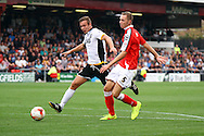 Crewe Alexandre's George Ray passes to his keeper under pressure from Port Vale's Tom Pope. Skybet football league one match, Crewe Alexandra v Port Vale at the Alexandra Stadium in Crewe on Saturday 13th Sept 2014.<br /> pic by Chris Stading, Andrew Orchard sports photography.