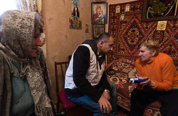 Doctor Khachatur Malakyan visits Lydia Momarov, 80, in her home in Debalsevo. After a checkup Dr Malakyan prescribes medicines for Lydia's hypertension.