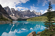 Blue-green Moraine Lake in Valley of the Ten Peaks, Banff National Park, Alberta, Canada. Banff is part of the big Canadian Rocky Mountain Parks World Heritage Site declared by UNESCO in 1984. Panorama stitched from 4 images.