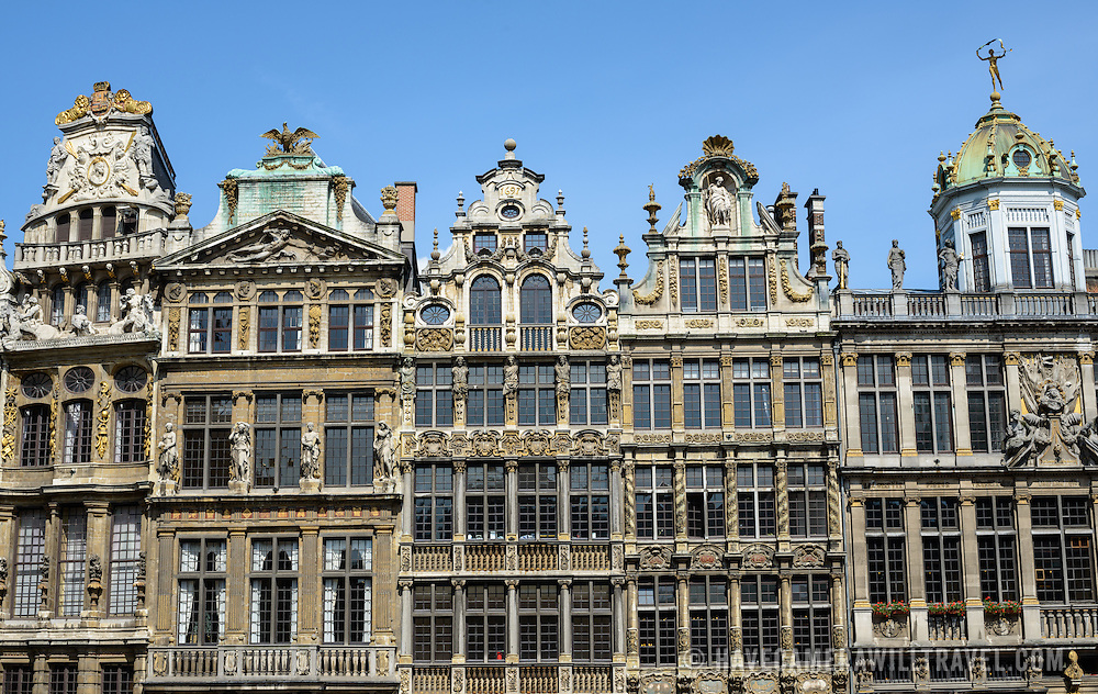 The ornate Baroque architecture of some of the Guildhalls in the Grand Place, Brussels. Originally the city's central market place, the Grand-Place is now a UNESCO World Heritage site. Ornate buildings line the square, including guildhalls, the Brussels Town Hall, and the Breadhouse, and seven cobbelstone streets feed into it.