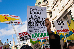 London, October 19th 2014. Hundreds of London's Kurdish community march throgh the capital in protest against ISIS and the Turkish government who they accuse, by not getting involved in military action against ISIS, of using the Jihadists to wipe out Kurds who have long been campaigning for an independent Kurdistan. PICTURED: A handmade placards supports the secular resistance of Kurds against ISIS and Erdogan's Turkish government.