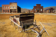Wooden sleigh and store fronts on Main Street, Bodie State Historic Park (National Historic Landmark), California