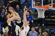 LA Clippers forward Blake Griffin (32) attacks the basket against Golden State Warriors center Zaza Pachulia (27) at Oracle Arena in Oakland, Calif., on January 28, 2017. (Stan Olszewski/Special to S.F. Examiner)