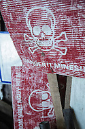 Weathered red warning signs bearing skull and crossbones indicate a mine area, Quang Tri Province, Vietnam, Southeast Asia