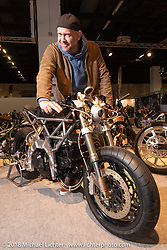 Custom bike builder and artist Roland Groteclaes of Belgium with his Custom Ducati 950 in the AMD World Championship of Custom Bike Building in the Intermot Customized hall during the Intermot International Motorcycle Fair. Cologne, Germany. Thursday October 4, 2018. Photography ©2018 Michael Lichter.