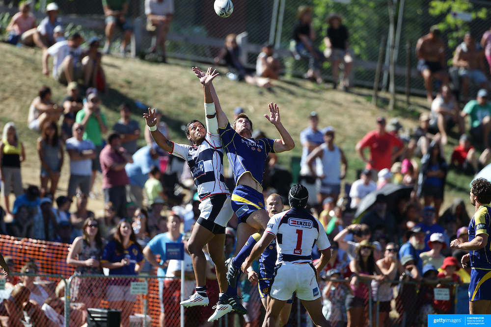 Auckland and Otago players contest for the ball during the Pub Charity Rugby Sevens 2012 New Zealand tournament at the Queenstown Recreation Ground, Queenstown, Otago, New Zealand. 8th January 2012. Photo Tim Clayton