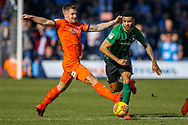 Luton Town forward James Collins tries to tackle Coventry City defender Jordan Willis (4) during the EFL Sky Bet League 1 match between Luton Town and Coventry City at Kenilworth Road, Luton, England on 24 February 2019.