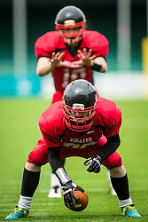 East Kilbride Pirates center snaps the ball - Mandatory by-line: Jason Brown/JMP - 27/08/2016 - AMERICAN FOOTBALL - Sixways Stadium - Worcester, England - Kent Exiles v East Kilbride Pirates - BAFA Britbowl Finals Day