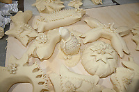 carved and decorated bread shapes on counter before cooking, Sardinian bread sculpture, the Pani Pintau